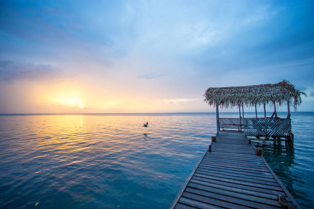 Sunset at dock in Belize stock photo