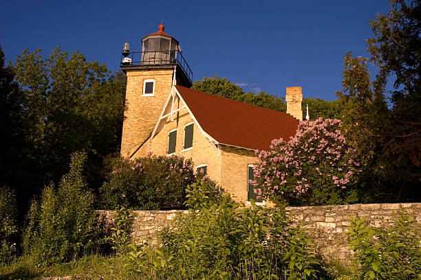 Sunset at Eagle Bluff Lighthouse in Door County Wisconsin stock photo