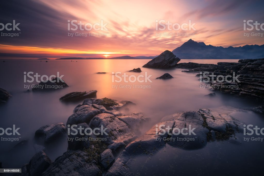 Sunset at Elgol, Isle of Skye, Scotland, UK. Long exposure over the rocks stock photo