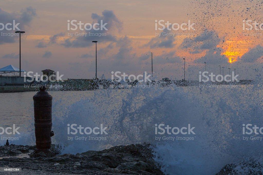 Sunset at Fredricksted Pier with Splashing Water stock photo