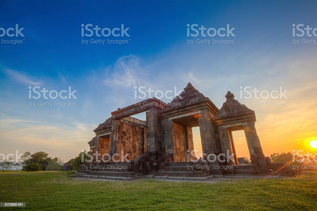 Sunset at Gate of Ancient palace Ratu Boko in Indonesia stock photo