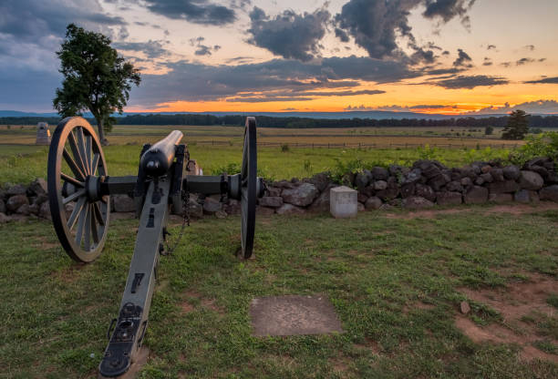 Sunset at Gettysburg National Military Park (Civil War Cannon) Sunset at Cemetery Ridge looking toward Seminary Ridge and across the field of Pickett's Charge. american civil war stock pictures, royalty-free photos & images