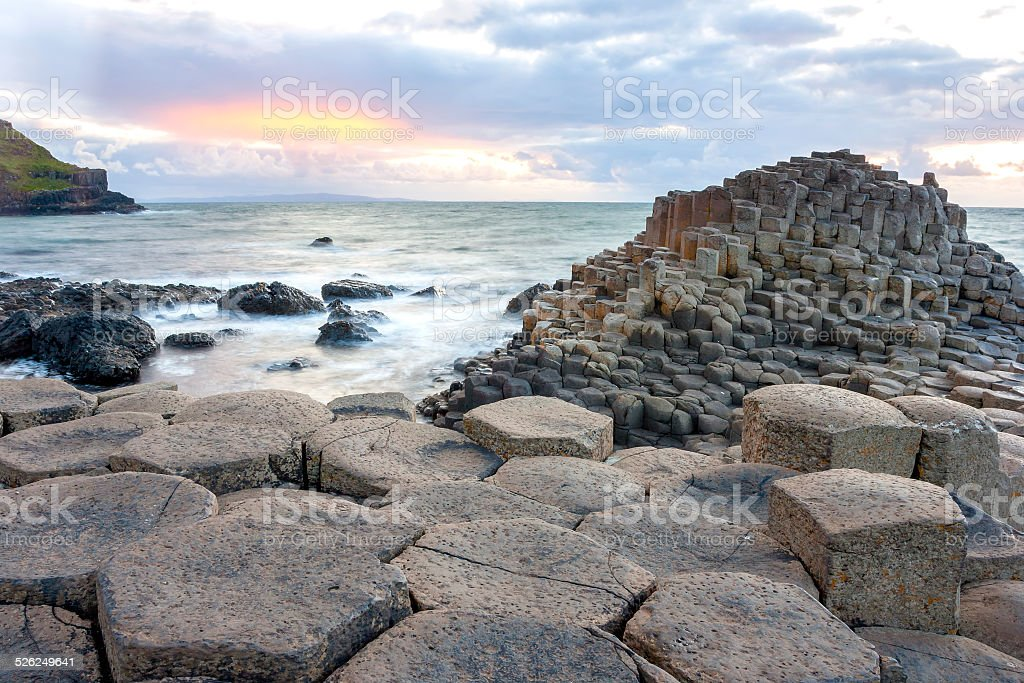 Sunset at Giant s causeway stock photo