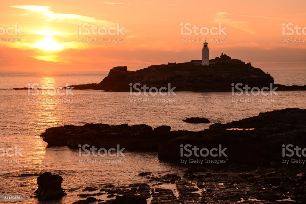 Sunset at Godrevy Lighthouse Cornwall royalty-free stock photo