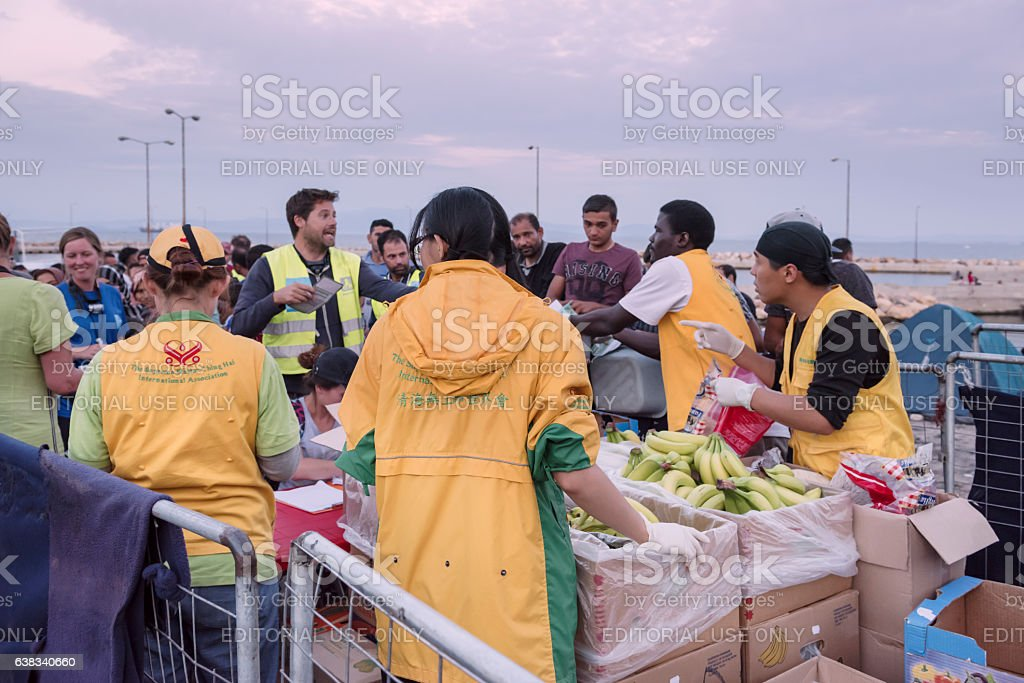 Sunset at Greek refugee camp as volunteers are serving supper stock photo
