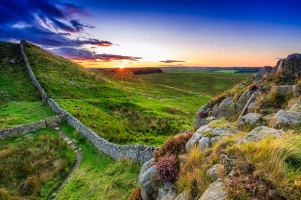 Sunset at Hadrian's Wall Sunset at Hadrian's Wall in Northumberland, England cumbria stock pictures, royalty-free photos & images