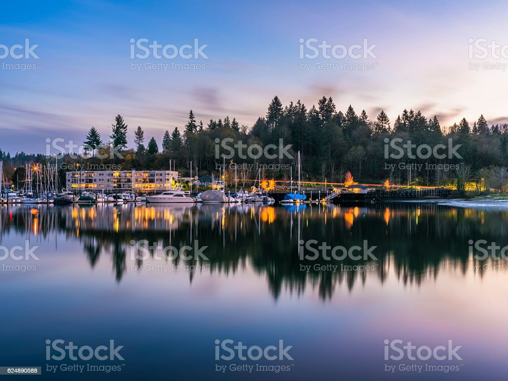 sunset at harbor with MT Rainier background stock photo