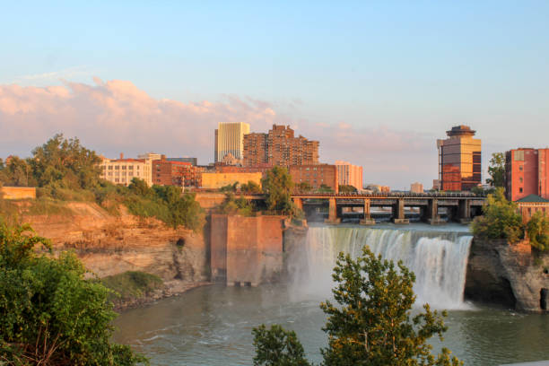 sunset at high falls, rochester, new york - rochester ny skyline stock photos and pictures