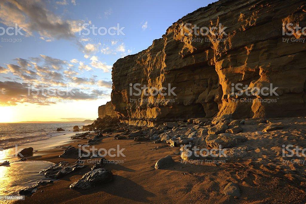 Sunset at hive beach, Burton Bradstock near Bridport, Dorset England. stock photo