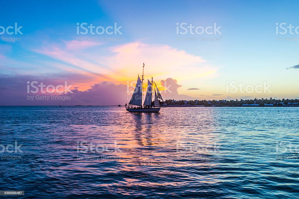 Sunset at Key West with sailing boat stock photo
