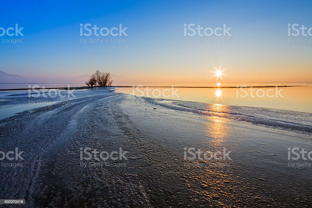 Sunset at lake Chiemsee in Germany at winter stock photo