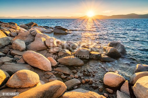 Stock photograph of the stony shores of Lake Tahoe, as seen from the Nevada side, USA at sunset.