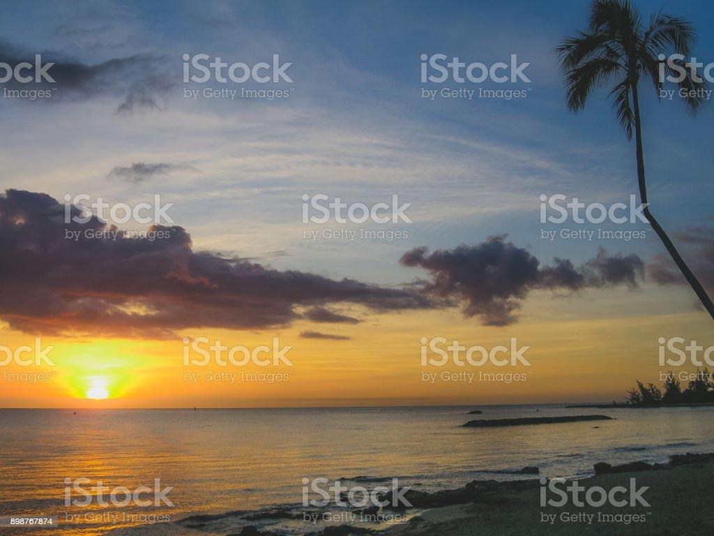 Sunset at Laniakea Beach stock photo