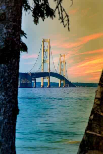 sunset at mackinac bridge - mackinac island stock photos and pictures