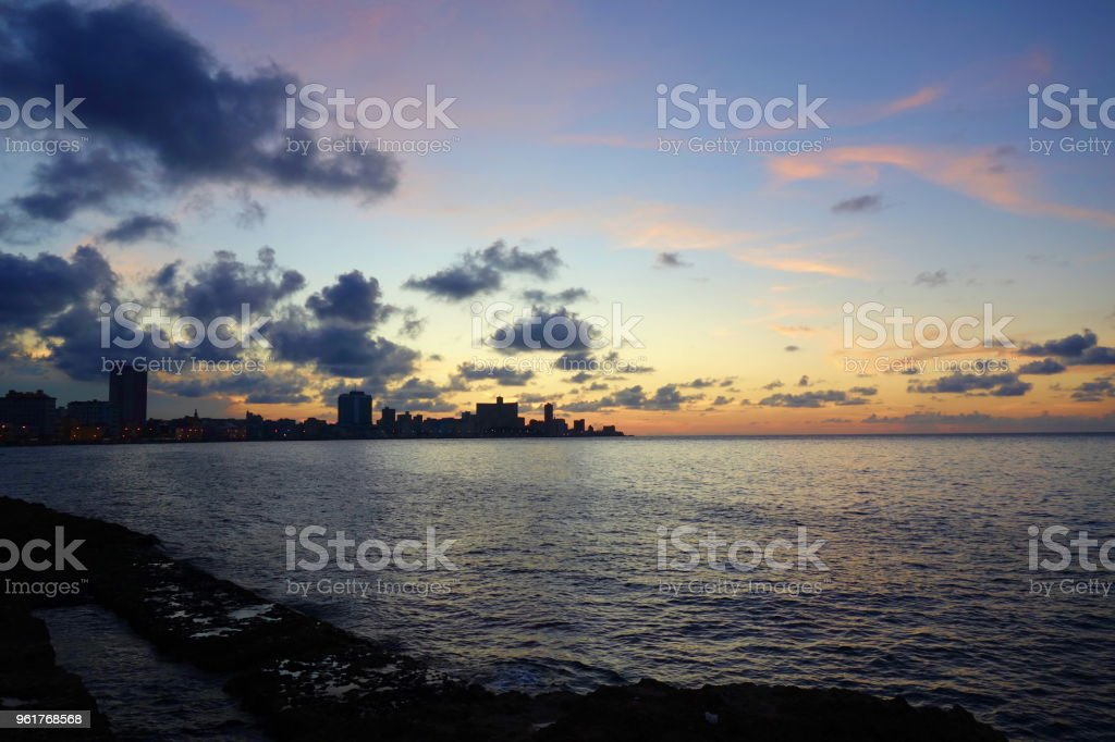 Sunset at Malecon, the famous Havana promenades where Habaneros, lovers and most of all individual fishermen meet, Havana, Cuba stock photo