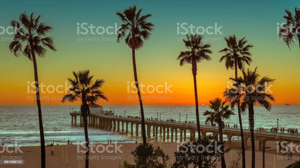 Sunset at Manhattan Beach and pier. Vintage processed. stock photo