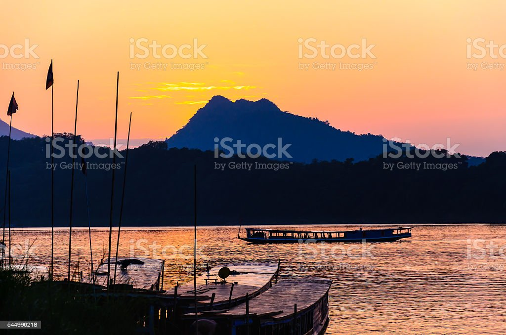 Sunset at Mekong river in Luang prabang,Laos. stock photo