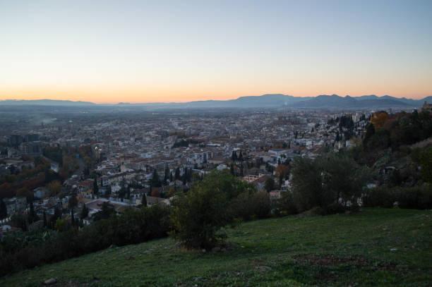 Sunset at Mirador del Barranco del Abogado Lookout with view onto Albayzin in Granada, Spain stock photo