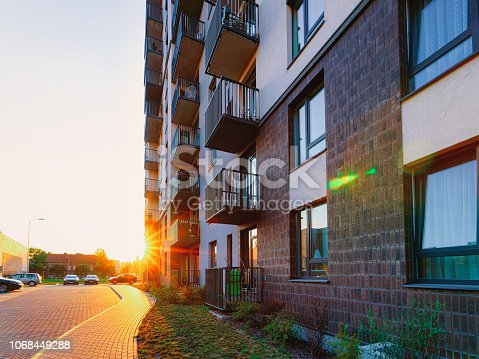 1165384568 istock photo Sunset at Modern new apartment house home real estate outdoor 1068449288