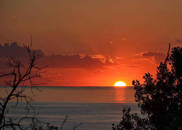 Sunset at Mount Baldy Sunset over Lake Michigan from Mt. Baldy sand dune, Indiana Dunes National Lakeshore mount baldy stock pictures, royalty-free photos & images