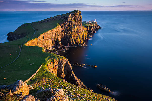 Sunset at Neist point lighthouse, Scotland Sunset at Neist point lighthouse, Scotland, United Kingdom isle of skye stock pictures, royalty-free photos & images