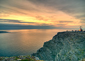 Sunset At North Cape In Norway On A Sunny Summer Day At Dusk With Only A Few Clouds In The Sky