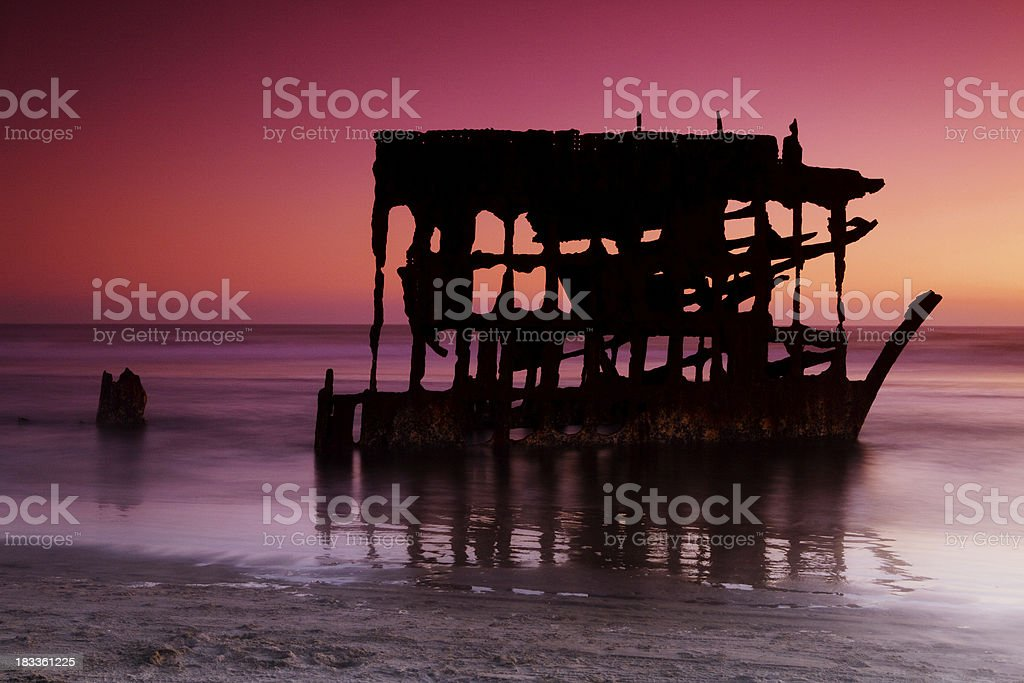 sunset at peter iredale stock photo