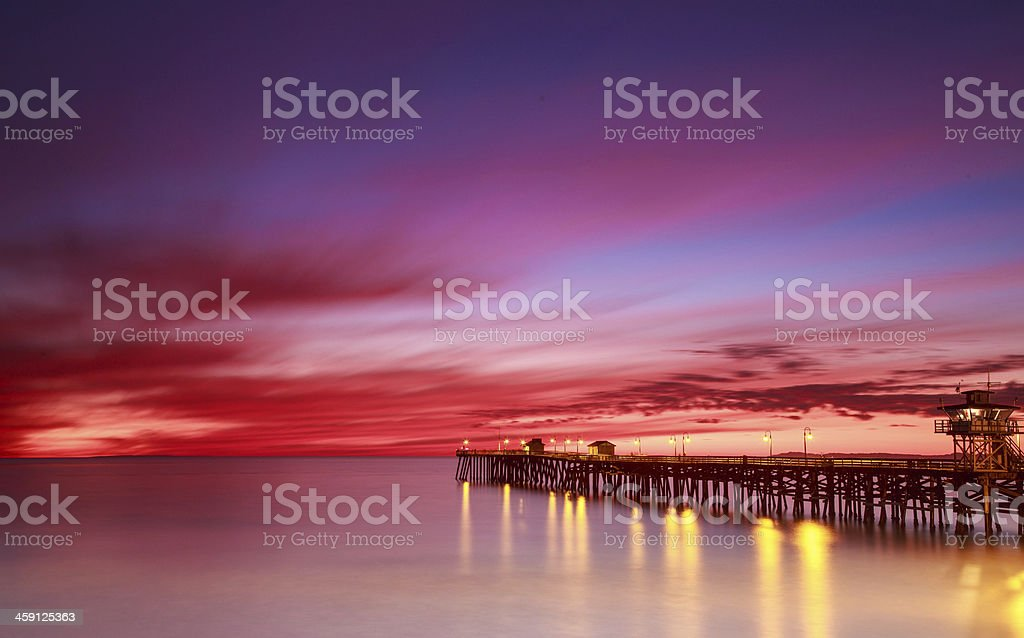 Sunset at pier stock photo