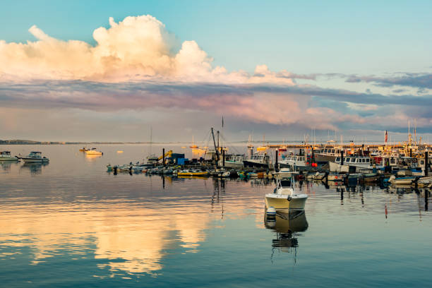 Sunset at Provincetown Marina A beautiful landscape at MacMillan Pier in Cape Cod Massachusetts. provincetown stock pictures, royalty-free photos & images