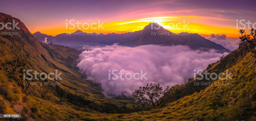 Sunset at Rinjani basecamp and the cloud over Segara Anak lake. stock photo