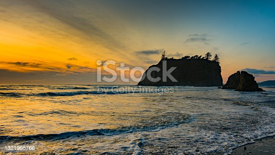 istock Sunset at Ruby Beach. Huge stones in the water. The sun reflects in waves. Olympic National Park, Washington state, USA 1321965766