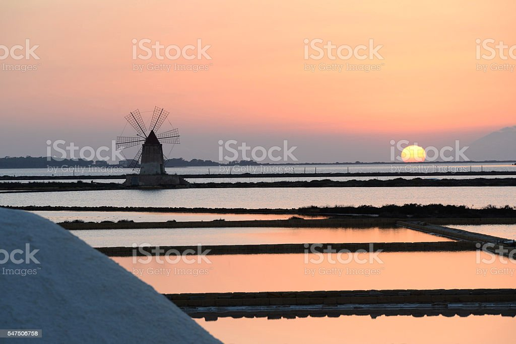 Sunset at Saline Marsala and windmills stock photo