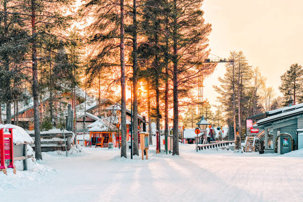 Sunset at Santa Claus Village in Lapland Sunset in Santa Claus Village in Rovaniemi in Lapland in Finland. village stock pictures, royalty-free photos & images