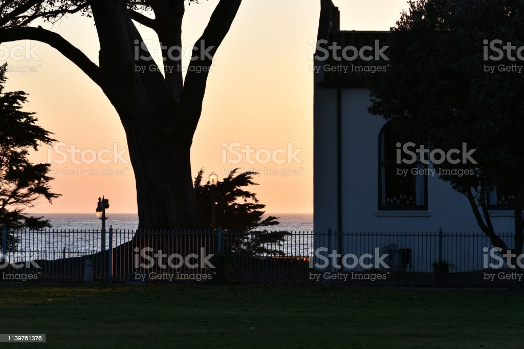 Sunset at Seaside Park with Building and Tree stock photo