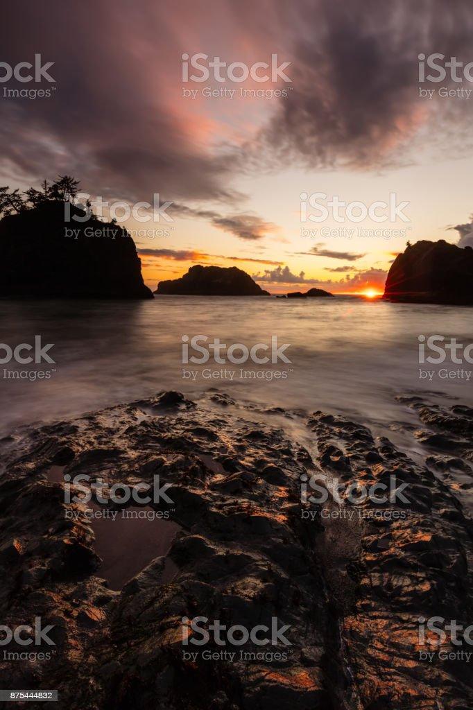 Sunset at Secret Beach on the Southern Oregon Coast stock photo