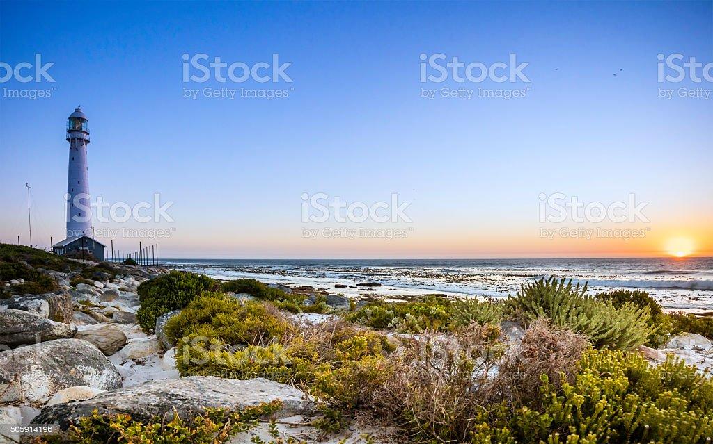 Sunset at Slangkop lighthouse at the beach stock photo