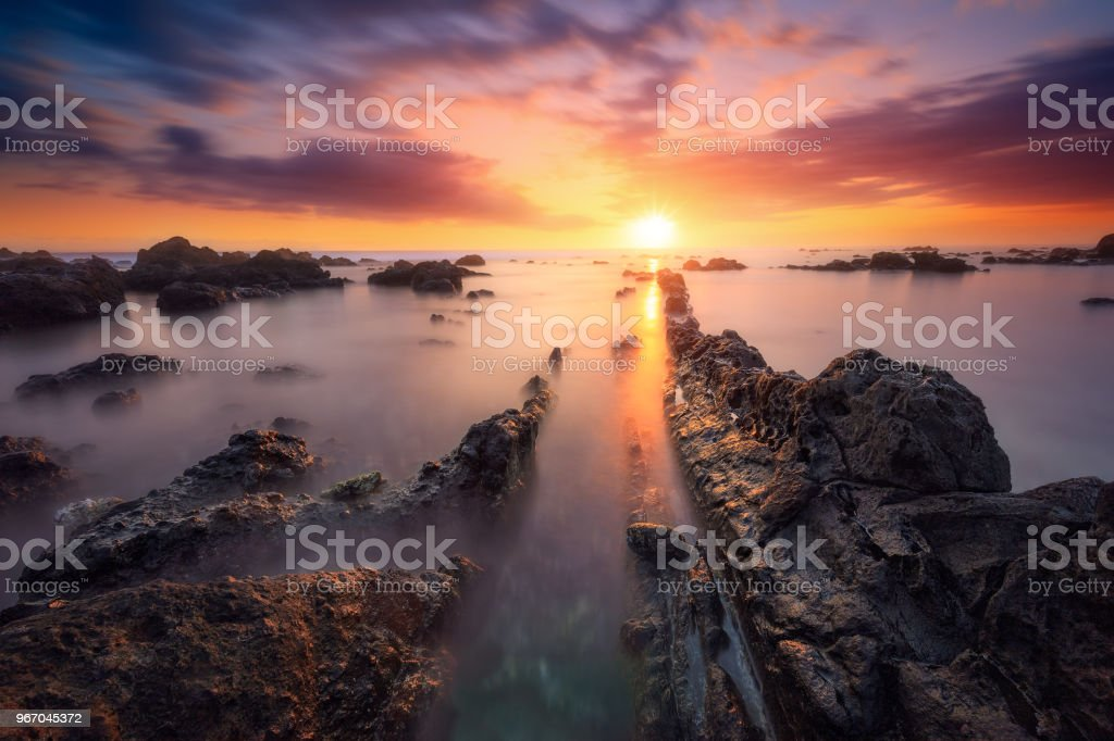 Sunset at Souris Chaude beach in Trois Bassins, Reunion Islan stock photo
