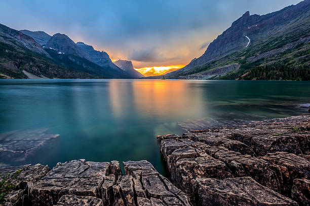 sunset at st. mary lake, glacier national park, mt - going to the sun road stock pictures, royalty-free photos & images
