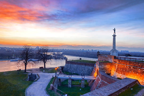 sunset at statue of victory in belgrade, serbia - serbia stock photos and pictures
