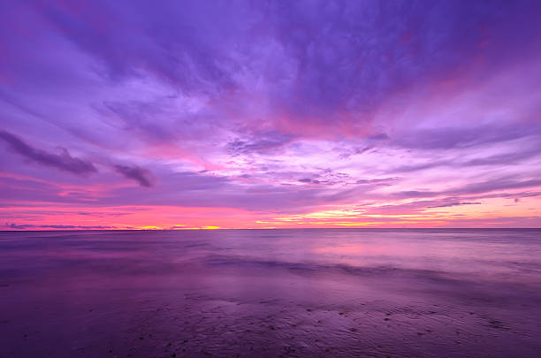 sunset at thap-tawan beach phang-nga province - violet stock photos and pictures