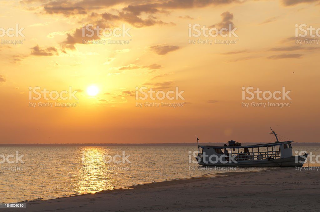 Sunset at the amazon river stock photo