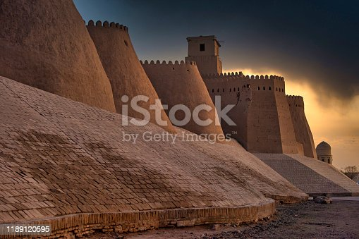 Last daylight at the city walls oft he ancient city of Khiva, one of the most famous places at the historic silk road.  Khiva was also known in the past as Kheeva, Khorasam, Khoresm, Khwarezm, Khwarizm, Khwarazm, Chorezm.