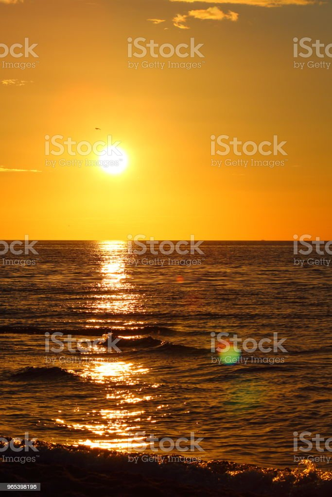 sunset at the baltic sea beach of ustronie morskie, poland royalty-free stock photo