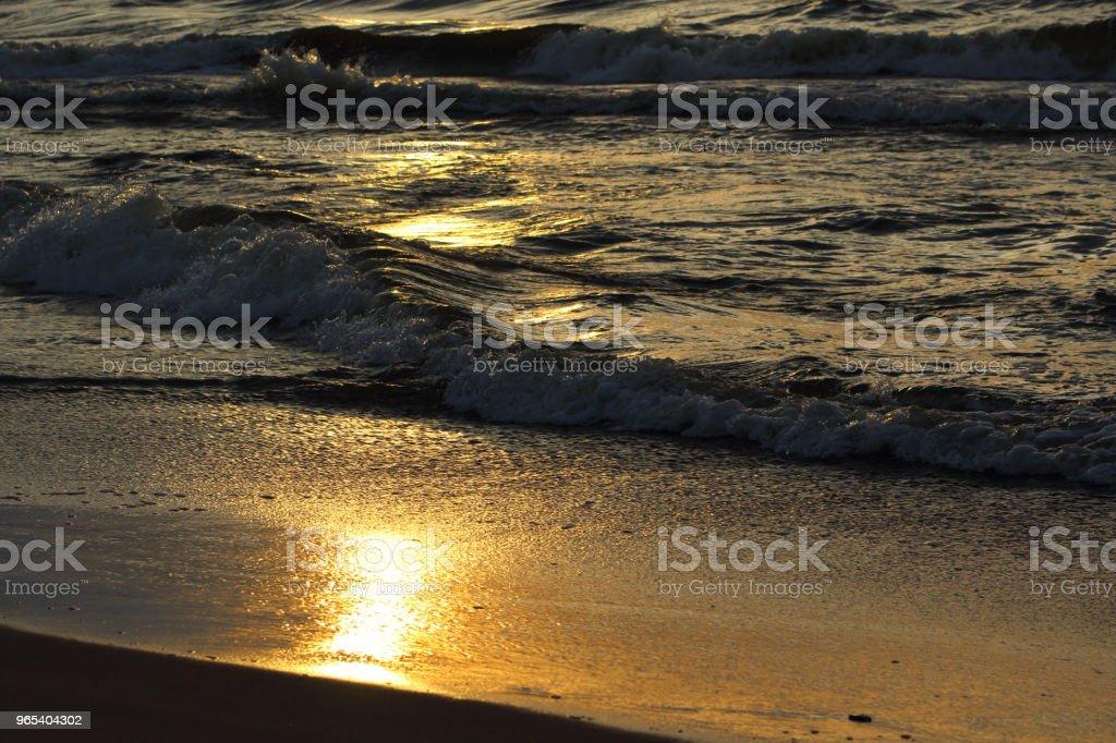 sunset at the baltic sea beach of ustronie morskie, poland zbiór zdjęć royalty-free