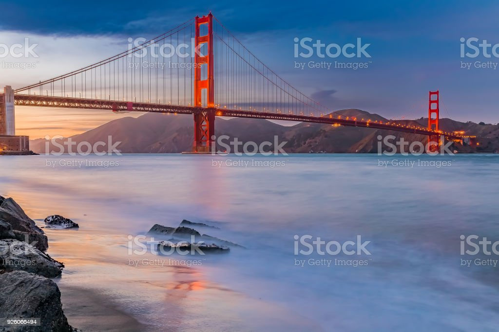 Sunset at the beach by the Golden Gate Bridge in San Francisco California stock photo