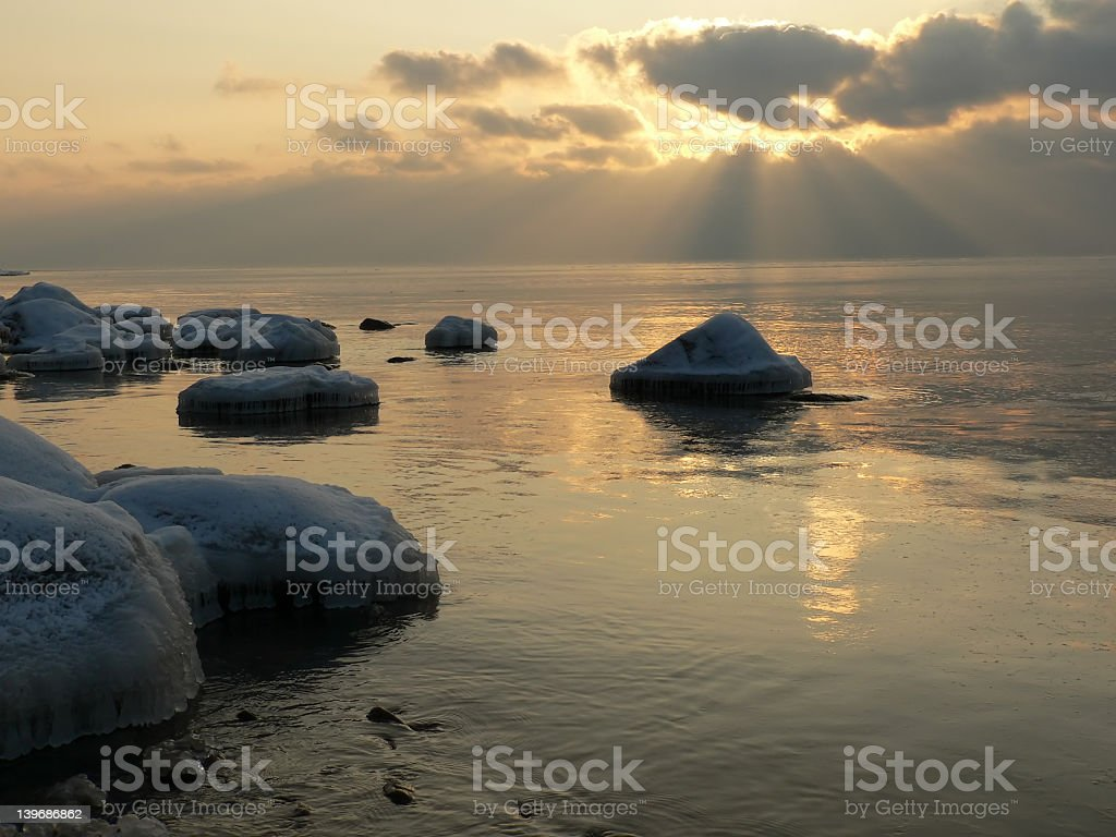Sunset at the beach in winter royalty-free stock photo
