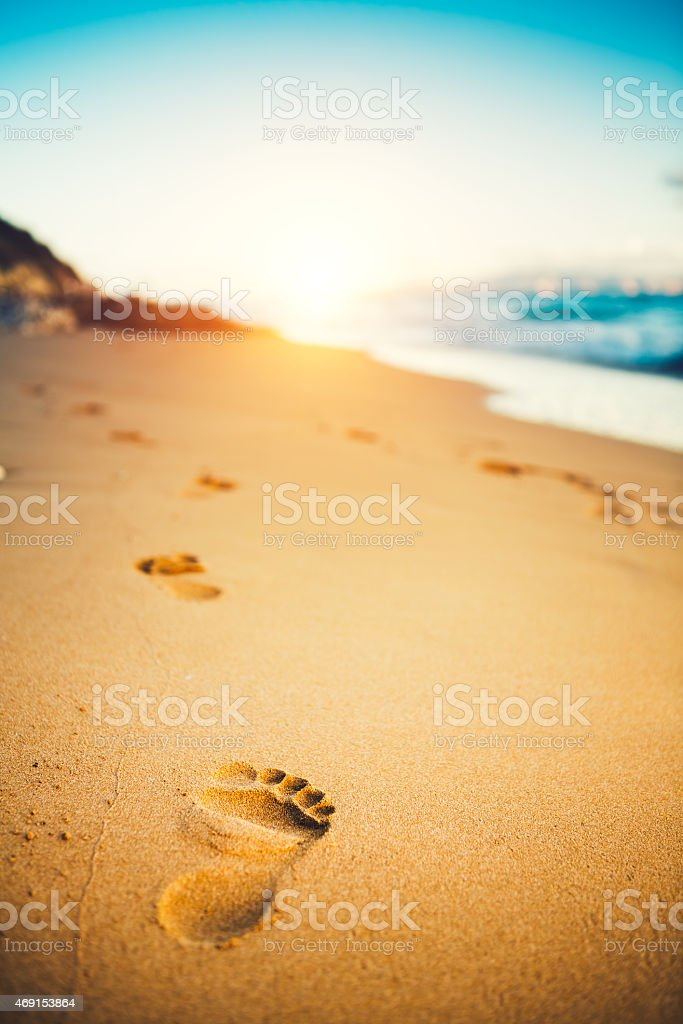 Sunset At The Beach With Footprints In The Sand stock photo