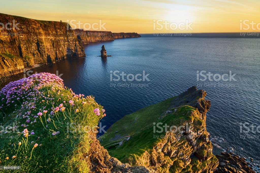 sunset at the cliffs of moher in county clare, ireland. beautiful evening scenic view from the wild atlantic way