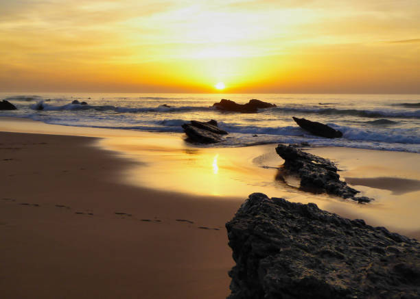 sunset at the famous beach Praia do Guincho in Portugal stock photo