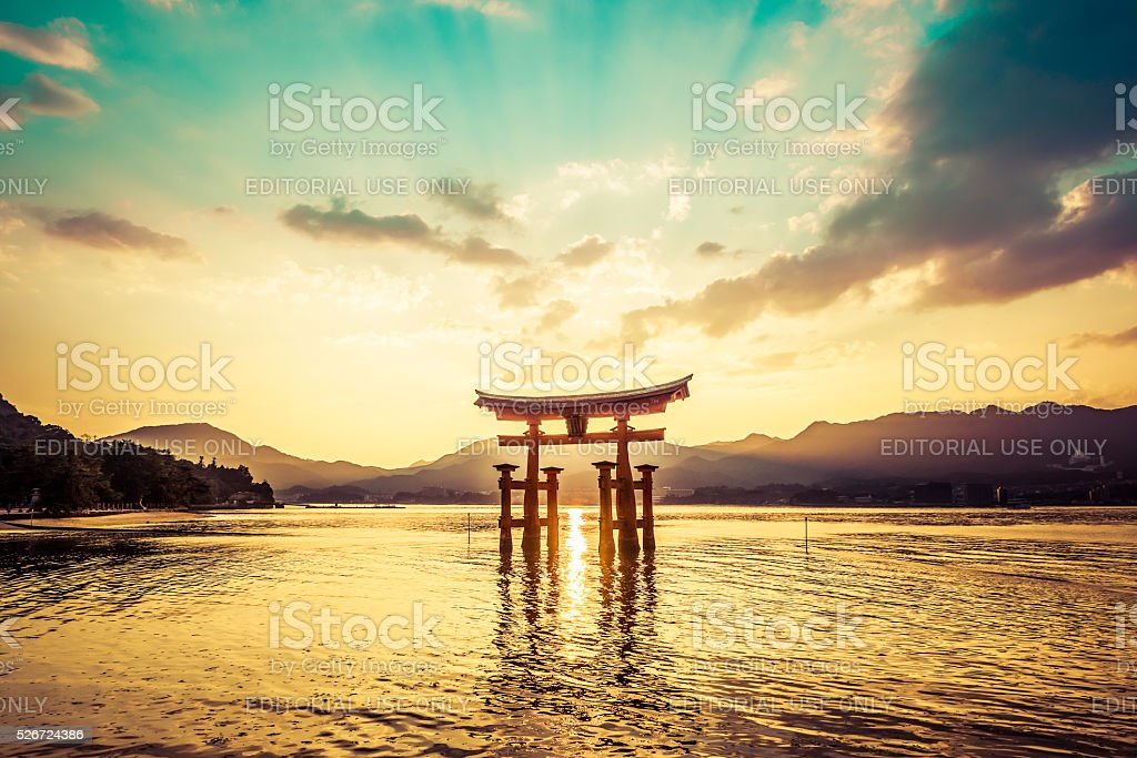 Sunset at the floating torii gate of the Itsukushima Shrine stock photo